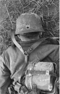 Soviet Union .- dead German soldier lying face down on earth, bullet hole in the helmet back