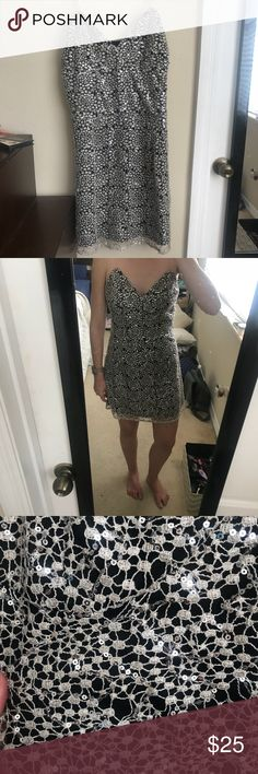 Sequins dress Size small with adjustable straps as pictured. Very pretty silver sequins over the black dress. A perfect NYE dress! Gianni Bini Dresses