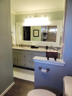 Dress up a standard bathroom mirror using trim for a frame.  This custom-looking frame was created by gluing a piece of casing and a baseboard to the existing mirror.