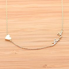 tiny heart & love you necklace. Love this <3