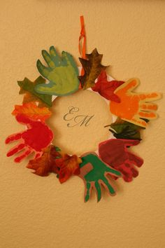 Autumn hand print wreath - For kids craft. I need to do this with autumn and kaden when autumn eventually cooperates with that kind of stuff lol
