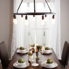 Brighten a hall, living room or dining area with this luminous ninelight chandelier. The attractive bronze finish and mix of modernand rustic elements adds styl