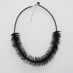 Gummihalsband, cykelslang, o-ringar. Rubber necklace, recycled inner tube, o-rings
