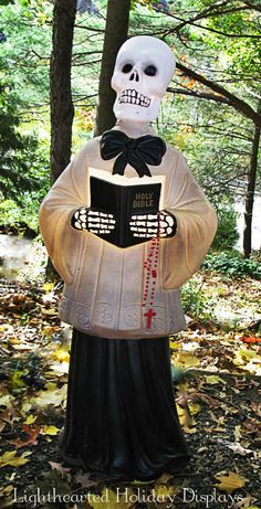 Look out Christmas Decorations!!!!  A Christmas caroler blowmold repurposed into a Halloween minister!!