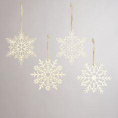 One of my favorite discoveries at WorldMarket.com: Laser-Cut Wooden Snowflake Ornaments, Set of 4