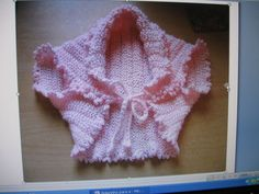 Bohlerino-is what they call it, a simple square folded...  This is knit, I'm going to try it with crochet.  It's a square