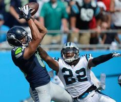 Seattle Seahawks' Jermaine Kearse (15) reaches up for a touchdown catch as Carolina Panthers' Josh Thomas (22) stretches out to defend durin...