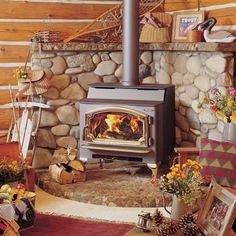 wood stove - stone hearth & mantel (other ideas: http://www.gokitchenideas.com/installing-wood-stove-stone-wall/installing-wood-stove-stone-wall-2/, http://www.countreeliving.com/Naturewoods-cedar-mantel.jpg)