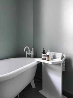 minimalist bathroom with soft green-grey color. by photographer stellan herner for residence mag/elle decor.