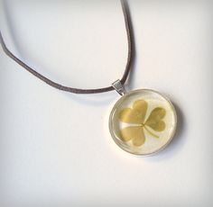 Shamrock necklace made with real pressed leaves on Etsy. $32