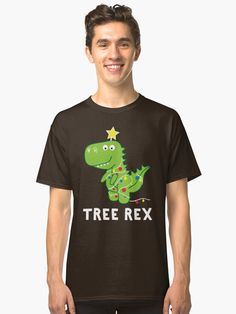 'Funny Christmas Dinosaur Tree Rex' Classic T-Shirt by teemaniac Christmas Tree Puns, Christmas Humor, Christmas Dinosaur, T Rex Humor, Pun Shirts, Dinosaur Gifts, Xmas Lights, Tshirt Colors, Gifts For Mom