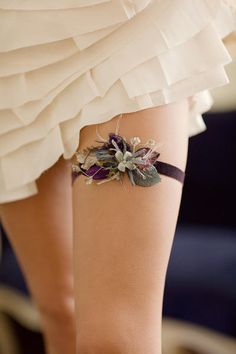 An adorable yet classy garter if I've ever saw one! I love the slight simplicity of it - I'm making my own (blue and purple) and I think I'll make 2 - one extra fancy one for me to keep, and one more simple garter for the toss :)