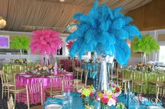 feathers for party centerpieces! Put in tall glass clear vases with lights:)