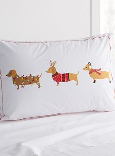Exclusively from Simons Maison     An irresistible pattern for dog lovers featuring a trio of dachshunds all dressed up for the holidays   Easy-care cotton-polyester blend   Standard size