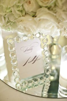 Use beautiful frames as your table numbers and then let the longest married couple at each table take it home.