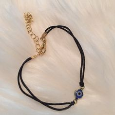 Black/Gold Chain Evil Eye Bracelet Brand new! Super cute! 15% off of bundles! FEEL LIKE MAKING AN OFFER? Please do it through the make an offer feature as I will no longer negotiate prices in the comments section. PRICE IS FINAL ON ITEMS $15 or less unless bundled. Jewelry Bracelets