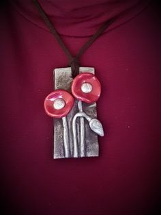 polymer clay with red shiny flower!