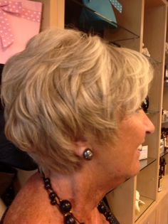 Highlights and lowlights on grey hair made a beautiful blonde.