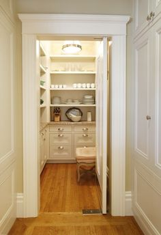 Love this pantry for the old back landing in the old part of the house (where the breaker box is). A counter an shelving on the wall with the breaker box, an a counter with just a small strip of shelving between the two windows on the other wall.