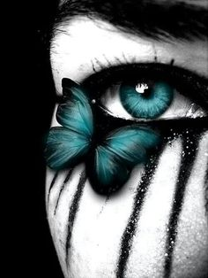 Teal make-up & contact lens.