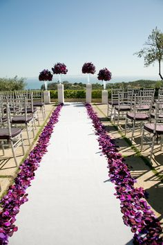 Luv this purple Wedding aisle flower décor, wedding ceremony flowers, pew flowers, wedding flowers, add pic source on comment and we will update it. www.myfloweraffair.com can create this beautiful wedding flower look.