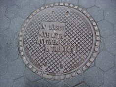 Lawrence Weiner NYC Manhole Covers. In 19 locations around New York.  • TYPO London