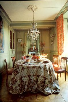Dining Room with antique patchwork for table covering