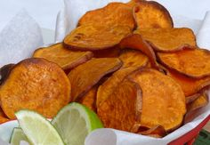*Sweet Potato Chips with Lime* 2 med size sweet potatoes, 2 Tbsp extra virgin olive oil, 1 lime, saly. Preheat 450o F. Thinly slice sweet potatoes. Lay slices on two foil covered baking sheets sprayed with cooking spray. Paint sweet potato slices with olive oil. Bake for 15-20 min. Place in bowl and squeeze a generous dose of lime juice over the baked chips. Sprinkle with salt.