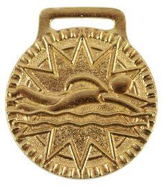 Medalla de natación en estilo dorado. Swimming medal in gold finished.