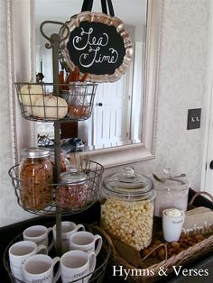 It's time to update my beverage center.  I like this idea.  The mugs would make a nice gift set with tea and cookies included.  Hospitali - tea: Creating a Welcoming Fall Vignette | Hymns and Verses