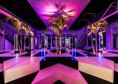 """Mirrored blocks, neon lights and tropical plants are combined to form this """"prismatic oasis"""" by Rafael de Cárdenas"""