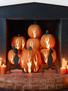 Carve pumpkins with fire images. Place in fireplace for unique Fall decor. Genius. yep. genius.