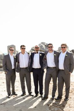 Mix and match groom + groomsmen outfit idea - groom in navy, groomsmen in gray {Boudoir Moderne by Allie Lindsey Photography}