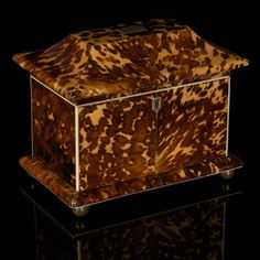 An English, Regency period, pagoda shaped tortoiseshell tea caddy, well matched panels with ivory stringing and the original matched covers within.