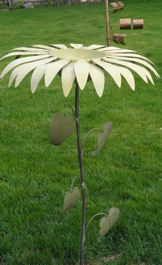 Recycled Metal Bird Bath/Bird Feeder.  Visit us on Facebook at Flying Pig Metal Art!