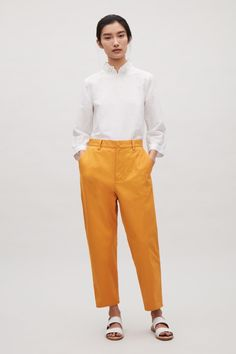Relaxed cotton chinos - Amber - Trousers - COS PT