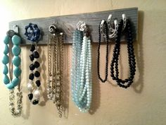 Mismatched knob necklace holder. Check out the water valve knob. Etsy.com   ShabbyWorks