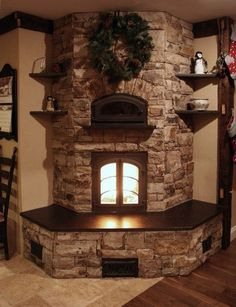 Country style stacked stone fireplace corner eith insert and many mantels