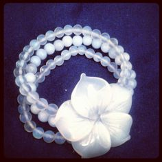 Handcarved opalite flower with opalite and blue chalcedany beaded bracelet $38