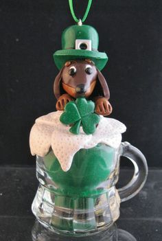 Clay Chocolate Smooth St. Patrick's Dachshund Green Beer Doxie. $25.00, via Etsy.
