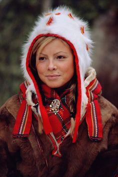 Portrait of pretty Sami girl in a traditional hat and peske at the Jokkmokk Winter Market. Sweden: Sami, Jokkmokk Market: Arctic & Antarctic photographs, pictures & images from Bryan & Cherry Alexander Photography.