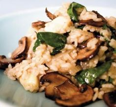Mushroom and spinach risotto made this tonight with panko crusted boneless pork loin chops! Amazing!!!!