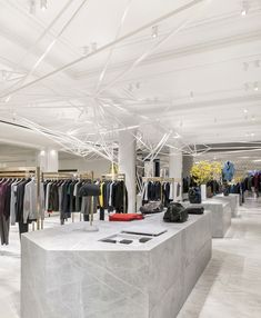 Selling Spaces: new directions in retail design Commissioned by established London department store Selfridges to design its new designer menswear space, architect Alex Cochrane has created, as part of its scheme, a geometric sculpture that stretches across the room's ceiling