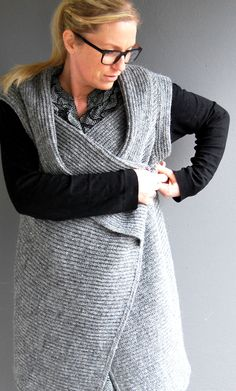 Eva Vilhelmsdóttir owner/designer at Utanium.  The philosophy behind Utanum design is based on the best that icelandic wool has to offer – the unique warmth.  The feeling being tucked in. A timeless flow that echoes the strong bond to Icelandic nature and culture. All the products of Utanum are produced in Iceland and handled with care all the way to the customer.  Icelandic wool is a natural product who's manufacturing is based on international environmentally-friendly principles.