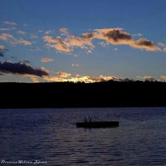 Sunset over Big Indian Lake, St. Albans, Maine, USA.