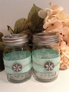 Aqua Blue and Ivory Lace Adorned Mason Jars Embellished with a Crystal Accent