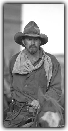 """Kevin Costner in Open Range. The film is set in 1882. """"Boss"""" Spearman (Duvall) is an open range cattleman, who, with hired hands Charley (Costner), Mose (Benrubi) and Button (Luna), is driving a herd cross country. Charley is a former soldier who fought in the Civil War and feels guilty over his past as a killer."""