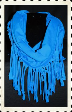 This infinity scarf has fringes all around. Can be worn just draped over shoulders or wrap it.