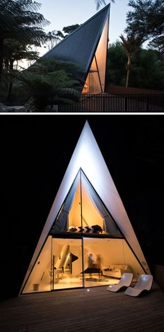 Architect Chris Tate has designed this simple tent-like cabin with a black exterior that's surrounded by trees and located on Waiheke Island, New Zealand.