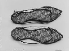 Funerary Sandals Period: Roman Period Date: A.D. 1st century ? Geography: From Egypt, Upper Egypt; Thebes, Deir el-Bahri, Priests' Houses, MMA excavations, 1923–24 Medium: Palm leaf, dye Dimensions: .67 x .25 m Credit Line: Rogers Fund, 1925 Accession Number: 25.3.224a, b
